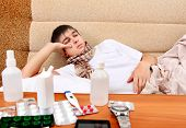 pic of home remedy  - Sad and Sick Teenager on the Sofa at the Home with Pills on foreground - JPG