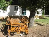 picture of ceres  - An old buckboard stands outside the rennovated old tollhouse in Mitchells pass near Ceres  - JPG
