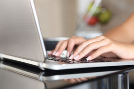 picture of self-employment  - Close up of a woman hands working with a laptop at home  - JPG