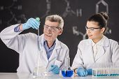 picture of professor  - Senior chemistry professor and his assistant working in laboratory - JPG
