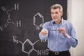 stock photo of professor  - Professor of chemistry leading lecture in University - JPG