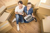 pic of  habits  - The young happy couple searching for apartments with laptop - JPG