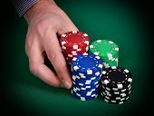 picture of poker hand  - dealer hands out poker chips close up - JPG