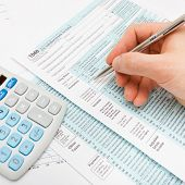 picture of cpa  - Filling out US 1040 Tax Form  - JPG