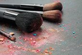 Picture of set of professional make up brushes on black background.
