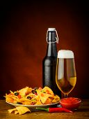 foto of nachos  - still life with nachos salsa dip and glass and bottle of beer - JPG