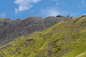 foto of slag  - View of Croesor Slate Mine spoil heaps and ruined huge drum house for incline - JPG