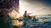 pic of hard-on  - Young lady paddling hard the sea kayak with lots of splashes - JPG