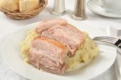 pic of pork belly  - Juicy pork belly slices on a bed of garlic mashed potatoes - JPG
