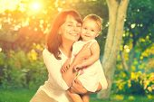 stock photo of joy  - Beautiful Mother And Baby outdoors - JPG
