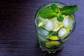 stock photo of mint leaf  - Alcoholic drink mojito with mint leaves is on the table - JPG