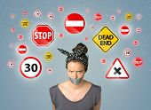 image of traffic signal  - Young woman with taped mouth and traffic signals around her head - JPG