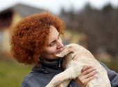 picture of baby goat  - Farmer woman holding a cute baby goat outdoor - JPG