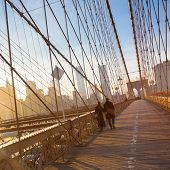 Постер, плакат: Brooklyn bridge at sunset New York City