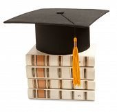 stock photo of academia  - Gortarboard and book - JPG