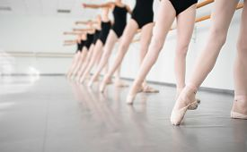 picture of classic art  - legs of young dancers ballerinas in class classical dance ballet - JPG