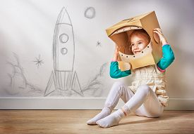 image of spaceman  - child is dressed in an astronaut costume - JPG