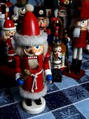 picture of tchaikovsky  - a santa claus nutcracker in the foreground with a crowd of other nutcrackers in the background - JPG