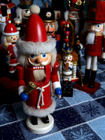 stock photo of tchaikovsky  - a santa claus nutcracker in the foreground with a crowd of other nutcrackers in the background - JPG