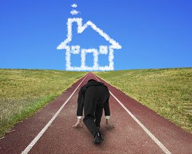 pic of track home  - Businessman ready to race on running track toward house shape clouds with blue sky background - JPG
