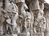 stock photo of trichy  - Classical Indian pillar Sculpture made out of granite stone depicting valour  - JPG