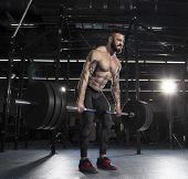 Attractive Muscular Athlete Doing Heavy Deadlift Exercise In Mod poster