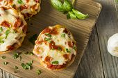 Homemade Pepperoni Mini Pizza Bagels poster