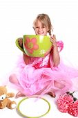stock photo of barbie  - Cute little girl having a tea party - JPG