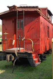image of caboose  - Rear view of a vintage red caboose - JPG