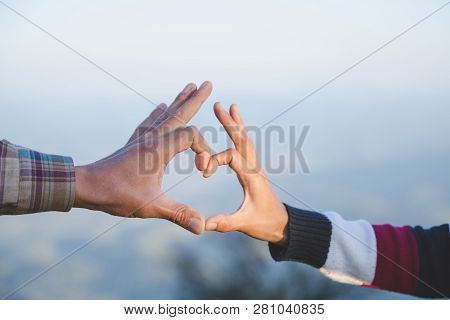 Heart In Hands Loving Couple