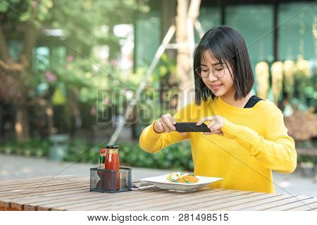 Young Asian Woman Food Blogger
