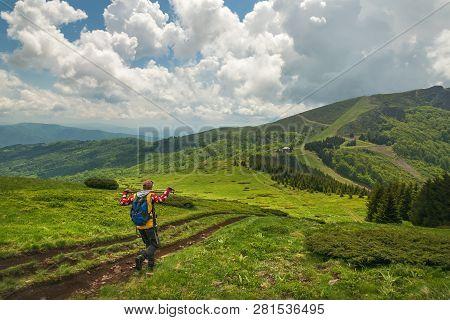 poster of Traveler Hike Alone On Mountain's Peak.
