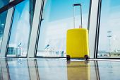 Isolate Traveler Tourist Yellow Suitcase At Floor Airport On Background Large Window, Bright Luggage poster