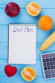 Healthy Eating, Dieting, Slimming And Weight Loss Concept. Fruits, Calculator And Notepad With Inscr poster