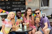 leisure, technology and people concept - happy young friends with food and drinks and taking selfie  poster