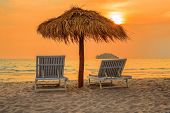 Beach Lounge Chairs Under Parasols On Tropical Beach At Sunset, Cambodia, Sihanoukville poster