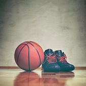 Basketball Background. A Pair Of Basketball Shoes On A Hardwood Floor Next To A Basketball. Retro To poster