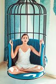 Peaceful And Calm. Woman Relax In Lotus Position At Home. Pretty Woman Learn To Meditate. Cute Woman poster