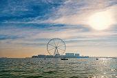 Ferris Wheel In Dubai, United Arab Emirates, From Blue Sea. Seascape, Skyline, Urban Landscape. Obse poster