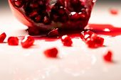 Closeup View Of Grain Red Grenades. Juicy Ripe Red Granets Or Garnets. Fruits Of Red Ripe Pomegranat poster