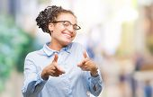 Young braided hair african american business girl wearing glasses over isolated background pointing  poster