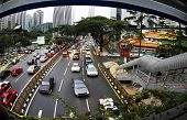 foto of klcc  - famous landmark of kuala lumpur with fast moving vehicle on highway - JPG