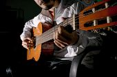 Guitarist Hands And Guitar Close Up. Playing Classic Guitar. Play The Guitar. Low Key Image. poster