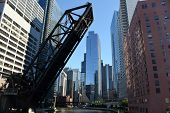 Raised Elevated Railroad Bridge Over The Chicago River With The Chicago Skyline Cityscape Of High Ri poster