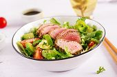 Tuna Salad. Japanese Traditional Salad With Pieces Of Medium-rare Grilled Ahi Tuna And Sesame With F poster