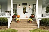 image of jack-o-laterns-jack-o-latern  - A beautiful front porch decorated for fall with sunflowers mums pumpkins pansies and a jack - JPG