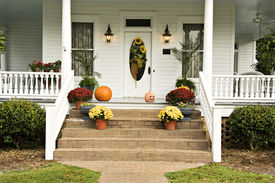 pic of jack-o-laterns-jack-o-latern  - A beautiful front porch decorated for fall with sunflowers mums pumpkins pansies and a jack - JPG