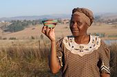 picture of zulu  - Traditional South African Zulu woman basket sales woman selling colourful ethnic baskets made from recycled wire - JPG