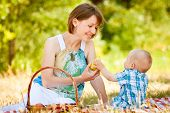Mom and son have a picnic