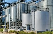 stock photo of silo  - Galvanised Iron grain silos on a farm in Eastern Europe - JPG
